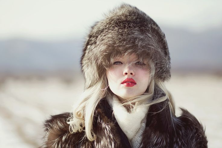 One of my favorite photographs. What makes it so great ... perhaps the way the color of her eyes and hair blends so well with the fur she's wearing. Truly an excellent photograph of a sensual model.  Great work Ksenia Vasilkova !!