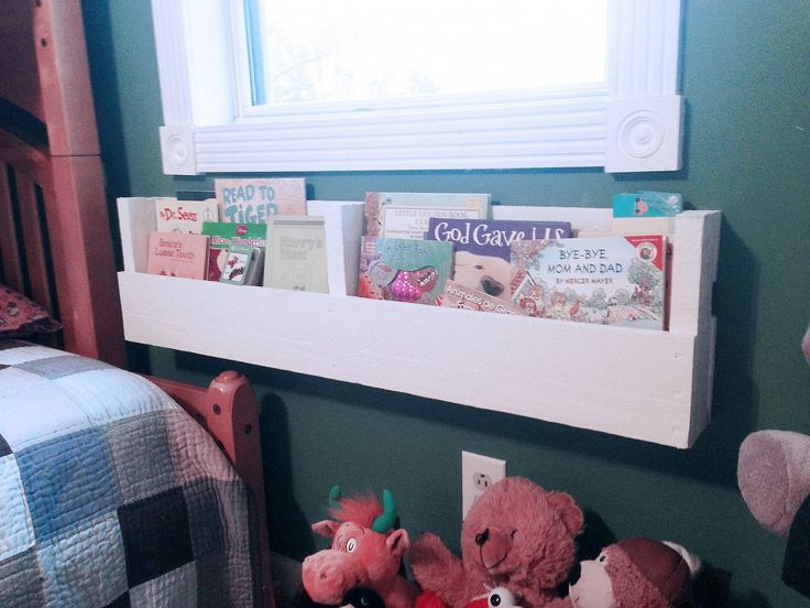 diy pallet bookshelves, pallet, shelving ideas, I mounted one of the 4 shelves directly underneath the window next to our kid s bed for easy bedtime reading access and cleanup