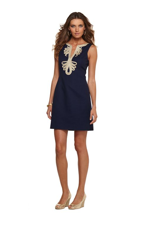 Lilly Pulitzer Janice Dress. Intricate swirling gold soutache dresses up the notched neckline of this flattering v neck navy blue shift dress. Add flat sandals and loose waves for a perfect post-beach party look. $188.00