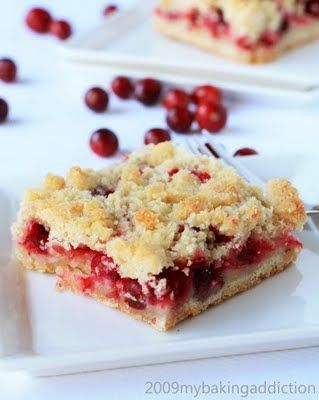 Cranberry Crumb Bars  Ingredients  1 cup white sugar  1 tsp baking powder  1/4 tsp salt  2 1/2 cups all purpose flour  1/2 cup almond meal*  1 cup cold butter (2 sticks)  1 egg  1/4 tsp cinnamon (I left this out by accident)  juice of 1/2 of an orange  4 cups fresh cranberries**  2/3 cup white sugar  1 tsp vanilla  1 Tbs cornstarch