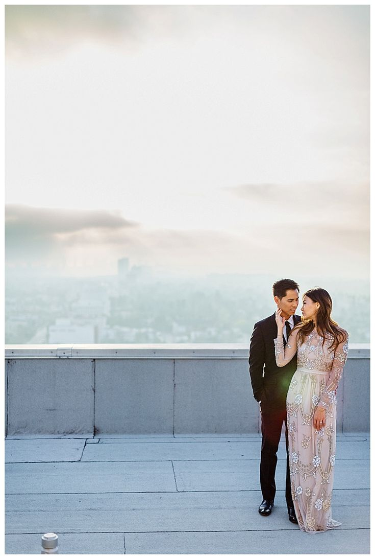 @janawilliamsxo / La Rooftop engagement session. Perfect engagement session dress by Needle & Thread / Bead embellished gown formal