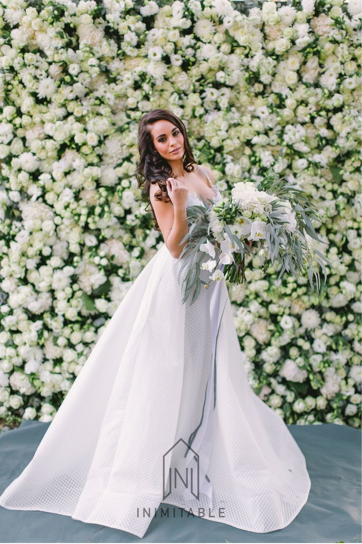 FLOWER WALL fit for a royal wedding.   Photography: @genevieve_fundaro  Hair and Make-up: @refinerythe  Dress: @calegrabridal  Floral Design: @zavionkotzeeventscompany  Venue: @inimitable_wv   #luxury #luxuryvenue #luxeweddings #luxewedding #flowerwall #allwhite #bride #bridal #floraldesign #bouquet flower wall, bride, white and green flowers, roses, wall of flowers, forest, dress, wedding day. bridal bouquet, bride, loose bouquet, floral,  best bouquet, best wedding