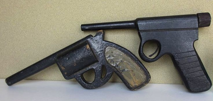 Pre-war wooden toy handguns. Crude representations of a Type 26 revolver, and a Nambu Type 14 pistol.