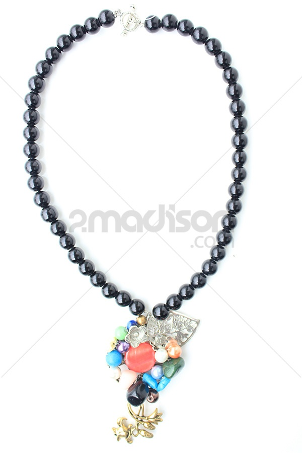 www.2madison.com  black pearls, painted shell, ornament, stone, and beads  Designer : Ana Jewelry  Collection : Colorfull Rock Collection