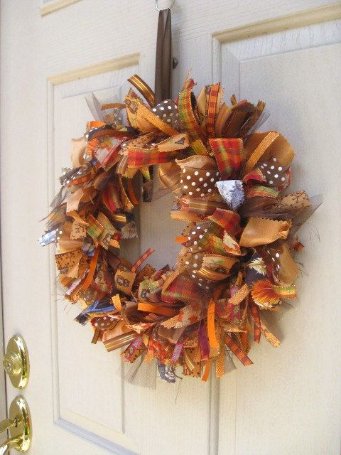 """Fall Ribbon Door Wreath for Fall Decor -We started with a 10"""" gold metal hoop for the wreath base and hand-tied on ribbons in orange, yellow, brown, gold and rust solids and prints that will coordinate with all your fall decor."""