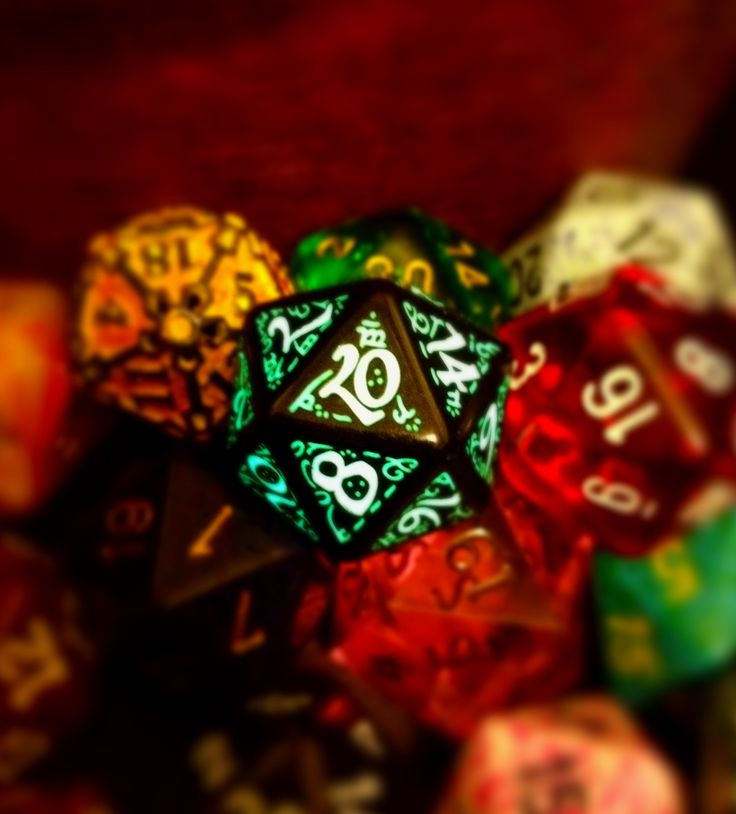 A glowing d20 I super charged with a blue laser.  I bumped up the saturation and then tilt-shifted with a center on the die. All done on my iPhone.( dungeons and dragons )