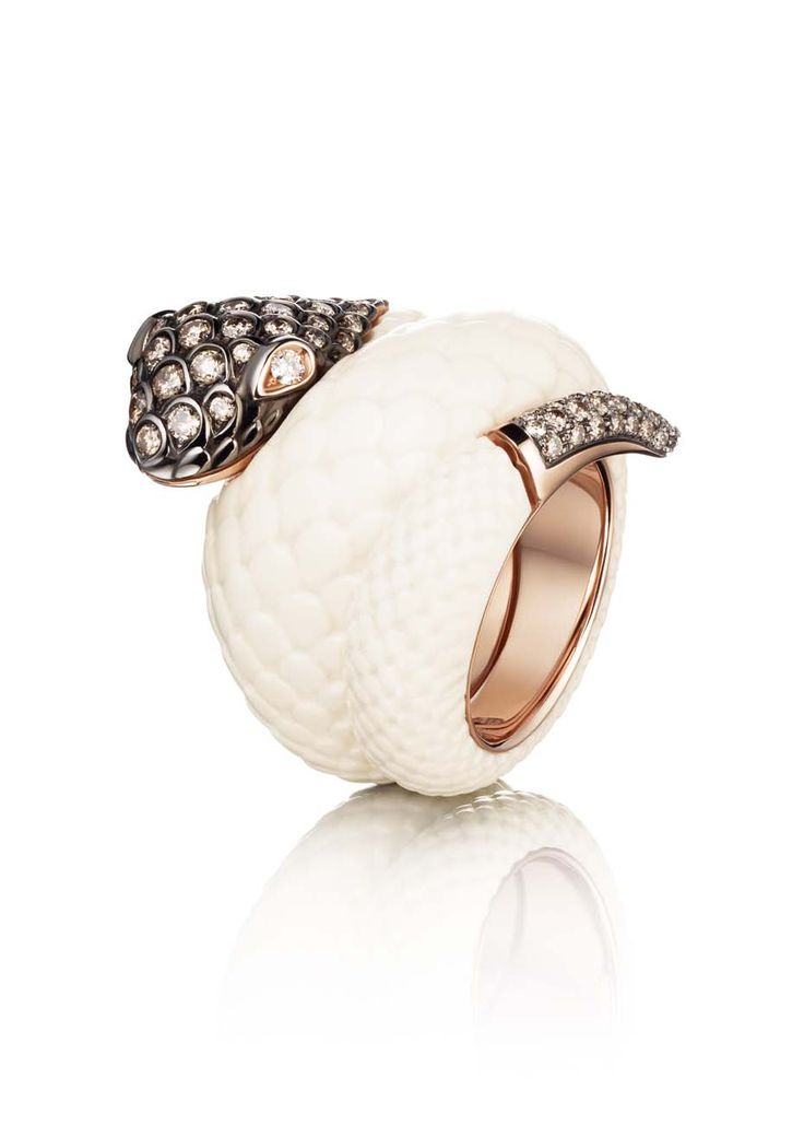 The de GRISOGONO pink gold Serpent ring, made with mammoth tusk and white and brown diamonds, worn by Cara Delevingne during the Cannes Film...