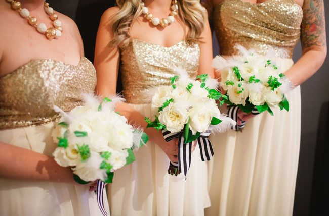 The older flower girls will carry petite (smaller than these!) bouquets of ivory garden roses and geranium leaves wrapped in blue-and-white-striped ribbon with the stems showing.  The youngest will carry a basket with white rose petals.