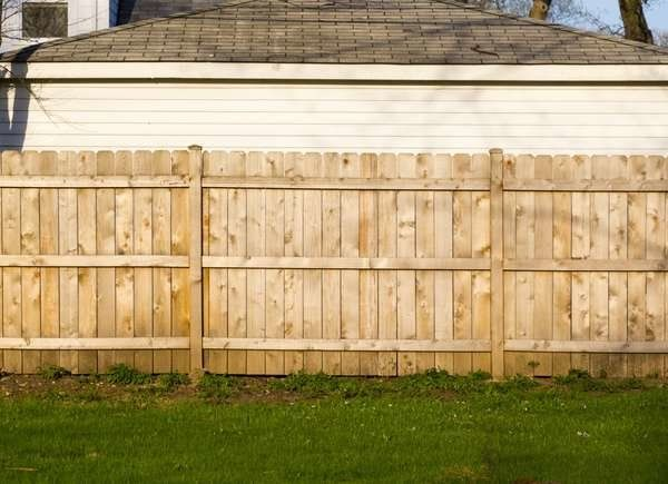 The Most Affordable Ways To Fence In A Yard Backyard Fences Wood Privacy Fence Fence Design