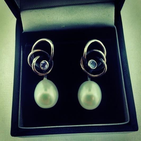Beautiful handmade silver Rabinovich earrings with Pearls and light blue zirconia's. For € 103.20.  http://www.goldbergjuweliers.nl/shop/products-page/rabinovich/rabinovich-oorbellen-11005065-zilver-parel-met-zirkonia