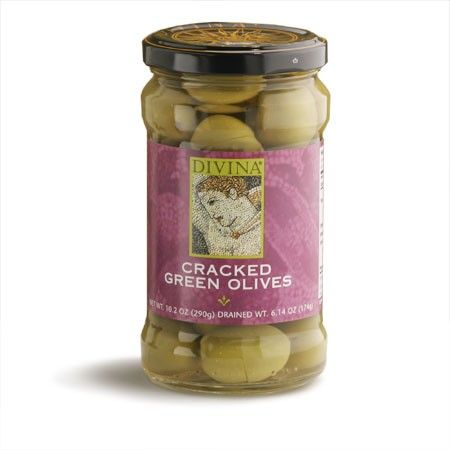 Cracked Green Olives - Grown in Greece on the slopes of Mt. Pelion and hand-picked while still young to preserve their mild fresh flavor. Meaty and buttery, these olives are hand-stuffed with sweet red peppers. Use these elegant olives straight out of the jar or as the ultimate luxurious cocktail olive.