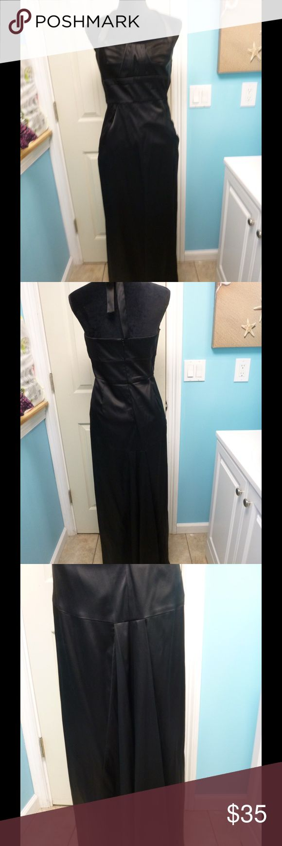 Donna Ricco black satin floor length halter dress This Donna Ricco dress is really pretty. It's black satin and floor length. The top is a halter style with a ruched neckline. There's boning on the top. There's a flattering pick up in the back. There is a zipper in the back. It was worn once and could be dry cleaned. It's size 10. It's made of 76% acetate, 22% nylon and 2% spandex. Donna Ricco Dresses