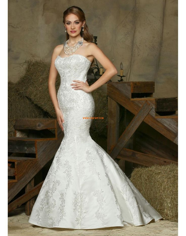 Classic Brides Will Adore This Da Vinci 50332 Bridal Wedding Gown.  Strapless, This Dress Has A Structured Bodice With Lace Overlay Throughout.
