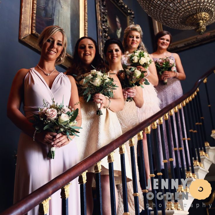 The bridesmaids wearing dusky pink