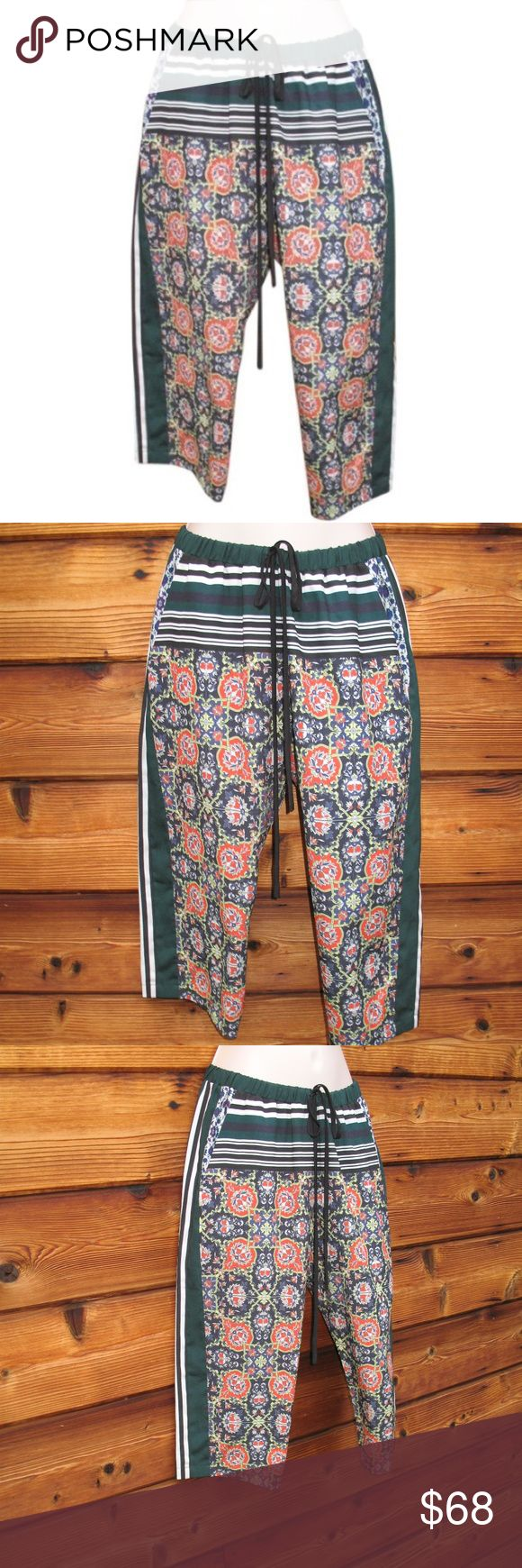 """Like New Clover Canyon Print Crop Capri Pants  M Clover Canyon Print Crops Pants   *Like-new  Details:  Clover Canyon  Size: M Color: Black/Multi  Pull-on style  Drawstring/elastic waist  100% Polyester   Measurements:  Waist: 28-38""""  Hips: 42""""  Inseam: 18 Clover Canyon Pants Capris"""