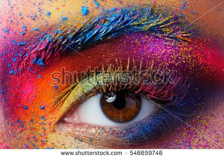 Close up view of female eye with bright multicolored fashion makeup. Holi indian color festival