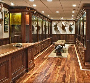 Gun Cabinet Trophy Room by Cabinetmaker Birdie Miller. My husband would love this ESP. If it was a secret hidden room in the house