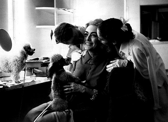 Joan Crawford with her adopted twins Cathy & Cynthia Crawford and two poodles
