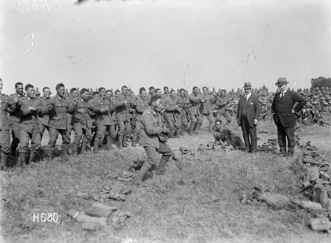Members of the Maori Pioneer Battalion perform a Haka for visiting N.Z. prime minister William Massey and deputy prime minister Ward, France, 1918. After Gallipoli the Native Contingent, along with Maori and Pacific Island reinforcements, was re-formed into a pioneer battalion.