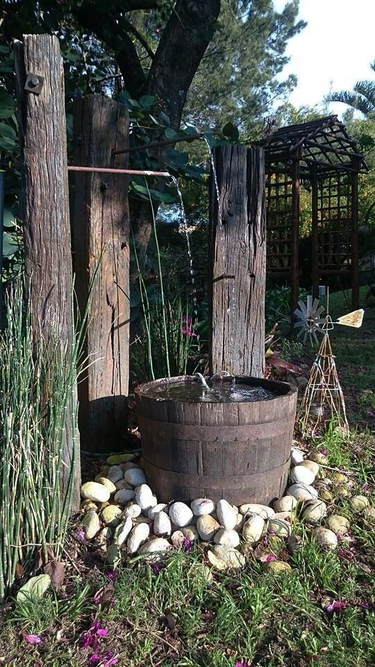 we had great fun designing this water feature using railway sleepers and an old wine