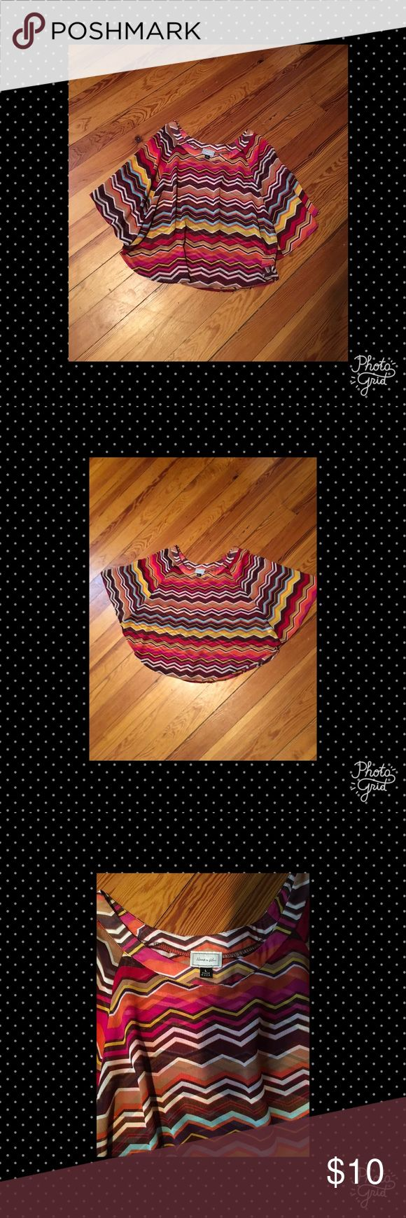 """""""About A Girl"""" Cocoon Blouse -Large Gorgeous pink, white, orange, yellow, teal and tan zig zag stripe blouse with cocoon/batwing sleeves. It is made by """"About A Girl"""" and is a size Large. The fabric is a lightweight polyester. About A Girl Tops Blouses"""