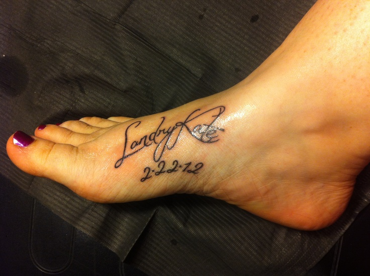 Daughters name and birthdate tattooed on my foot... I prob