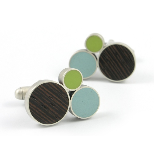 Cufflinks by Matthew Smith are the perfect finish for any gentleman's outfit at the Craft Alliance Dotted Ball! The Node cufflink features sterling silver circles filled with dark hardwood and hand cast eco-friendly resin. The cufflink mechanism is also sterling silver. $160