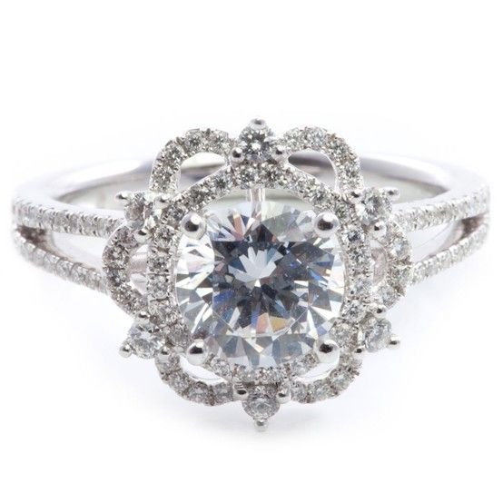 Vintage inspired 18K white gold engagment ring containing 98 round brilliant cut diamond accents.