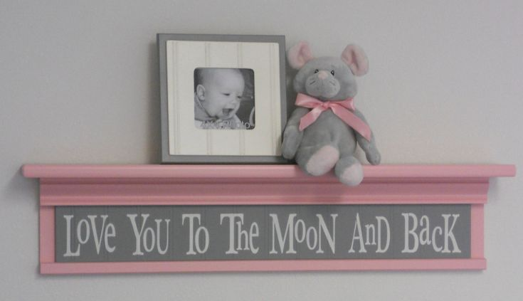"Pink and Gray Baby Girl Nursery Shelves - Love You To The Moon And Back Sign on 30"" Pastel Pink Shelf with Grey Nursery Wall Decorations. $53.00, via Etsy."