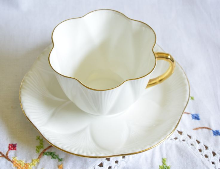 Shelley tea cup and saucer/ white dainty tea cup/ classic white tea cup/ molded petals on saucer by VieuxCharmes on Etsy