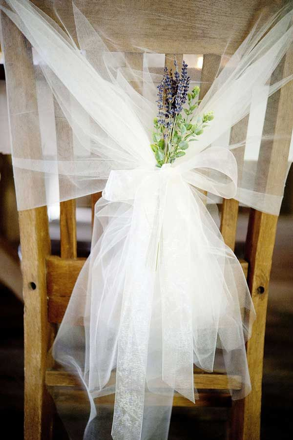 So lovely...love this tulle draping with a few sprigs of lavender as a chair decoration.  (Via 30 Budget-Friendly Fun and Quirky DIY Wedding Ideas)