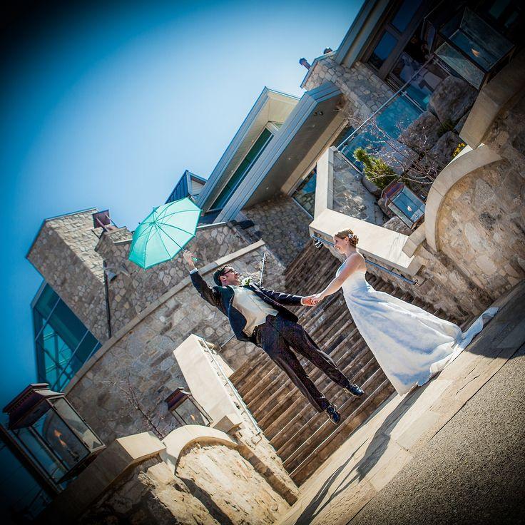Fun, Blue umbrella, A line dress, Stone, Staircase, Black suit, Tan vest, Cambridge Mill, Cambridge, Ontario, Canada wedding photography experts | Anne Edgar Photography