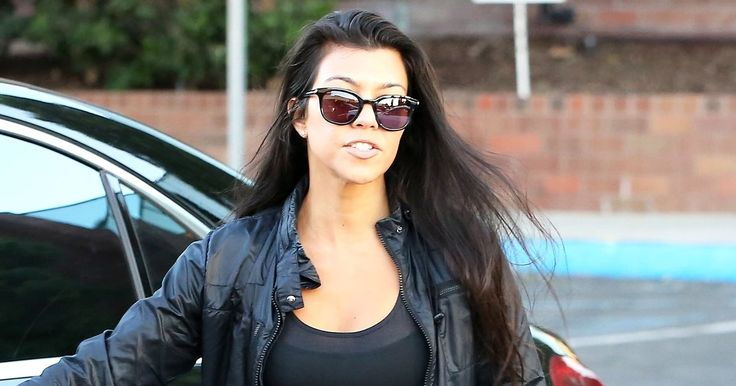 Back from Paris Fashion Week (and in the aftermath of sister Kim's robbery), Kourtney Kardashian emerged in Calabasas, California — read more