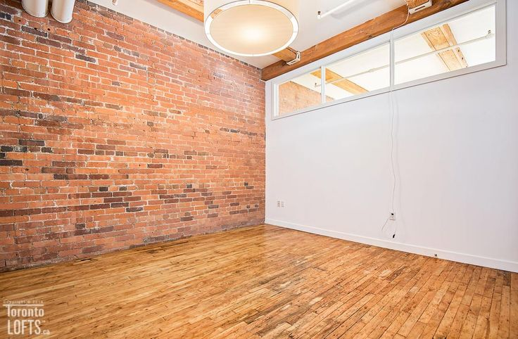 Imperial Lofts-80-90 Sherbourne St #401 | Large, bright 1100 sf East facing 2 bedroom + den post, brick & beam authentic loft for rent, 1 premium secure underground parking included. | More info here: torontolofts.ca/imperial-lofts-lofts-for-rent/80-90-sherbourne-st-401