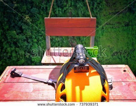 Helmet, Action Camera on the Table hang on the Zip Line at TadFane Waterfall Paksong Champasak Laos Image Background