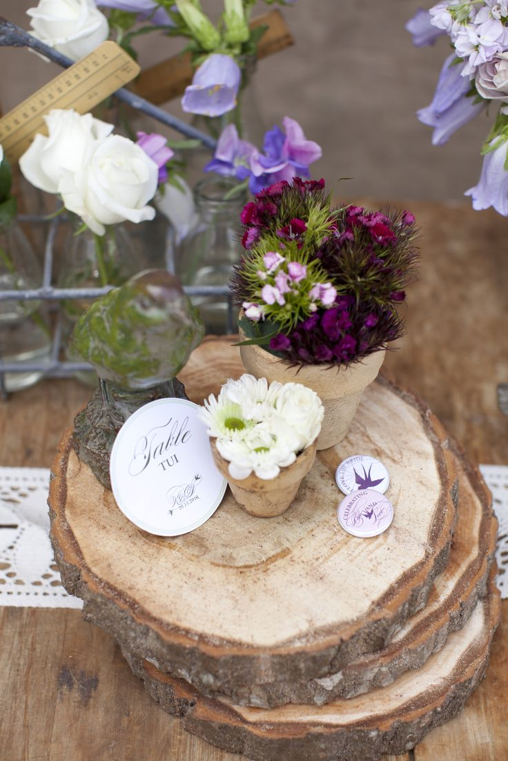 Stacks of tree-stump slices topped with terracotta pots brimming with bright blooms make tactile centrepieces. New Zealand Weddings Magazine, Spring 2013 issue. Photography by Jimena Murray.