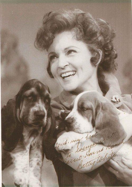 Betty White and basset hound puppies