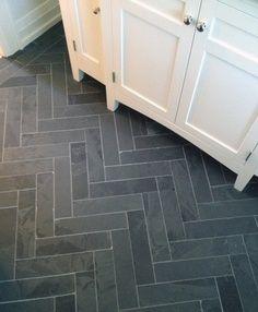 Grey Herringbone Tile Mudroom Floor