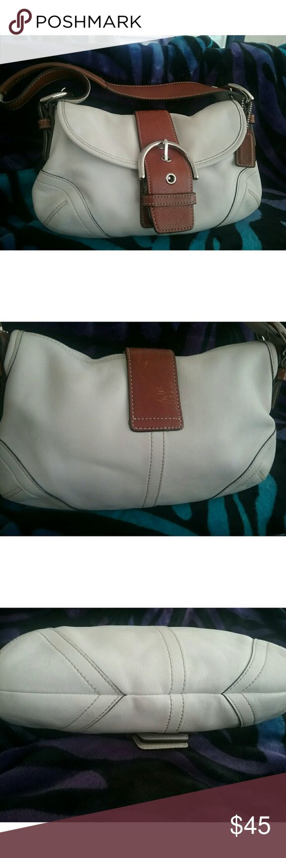 Coach  small tote,  white & brown, used This is a Coach purse, white and brown. Length is 6 inches ( without the strap) and width is 10 inches. Has some scratches. The most noticeable is on the back of the purse on the brown. Inside is clean. Coach Bags Totes