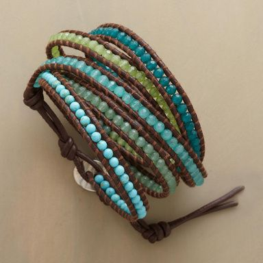 """WRAPSODY IN BLUE BRACELET--Turquoise, aventurine, jade and quartz encircle the wrist five times in a blue green spectrum. Stones aligned between leather cords. Handcrafted by Chan Luu with sterling silver button clasp. 32"""" to 34""""L."""