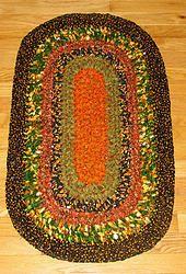 "#71 Oval - Shades of Autumn 34"" X 20"". Hand crocheted cotton fabric rag rug."