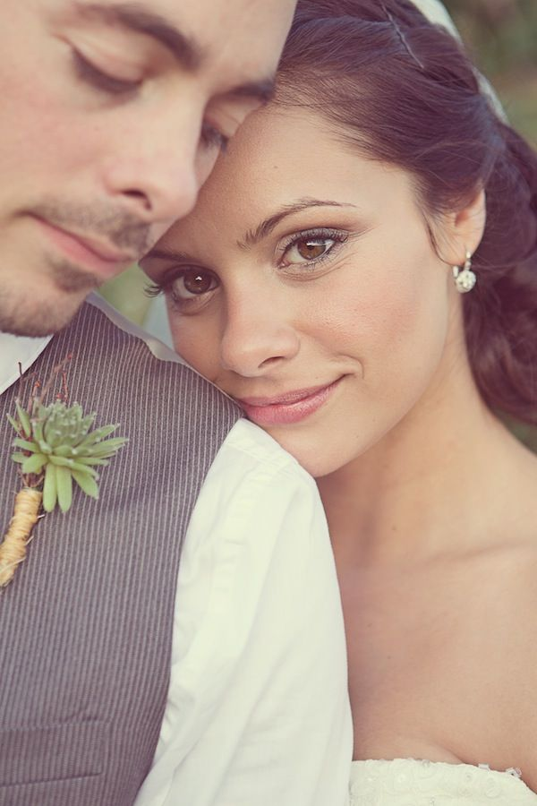 love everything about this-- hair and make-up, boutonniere.