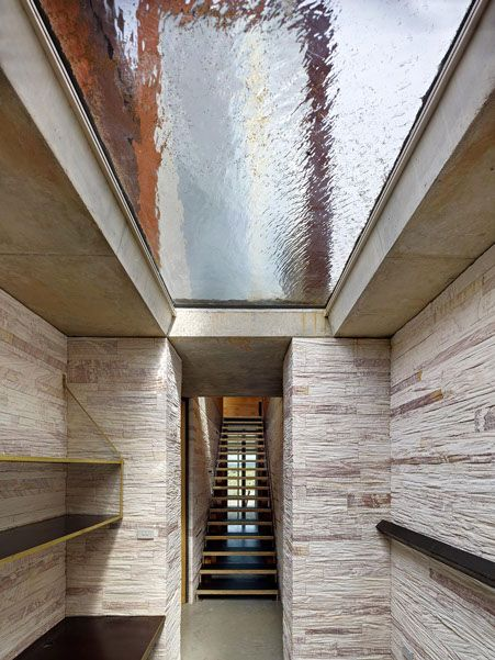 invisible house / peter stutchbury architecture / mudgee sandstone, water skylight , formply, brass