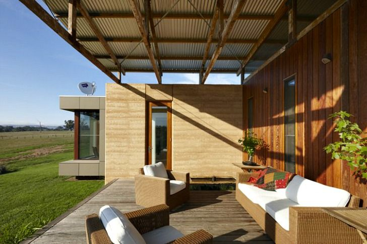 Corrugated iron, rammed earth and recycled timber deck