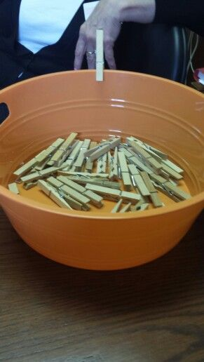 Sorting activities for dementia residents. Put the clothes pin around the rim of the bowl.