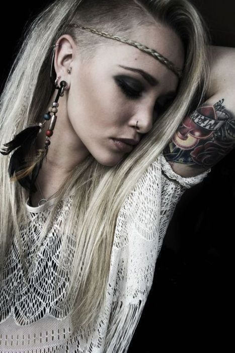 Edgy bohemian hair style - love the shaved side & plait headband. I'm a such fan of feather earrings & nose rings.