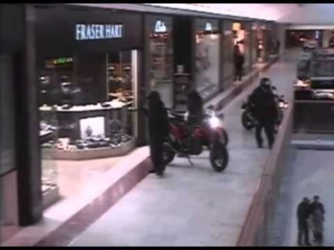 Daytime motorbike raid INSIDE shopping centre