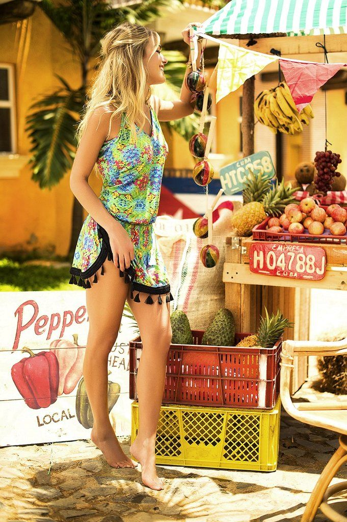 This tropical beach cover-upmakes us want to book a trip to to the Dominican Republic. This slip dress has adjustable straps and it drapes over the body perfectly. It has a semi-relaxed fit and adorably decorated with tassels around the hem. Slip on some flats and venture around the island in comfort. #coverup #tropical #travelinspiration
