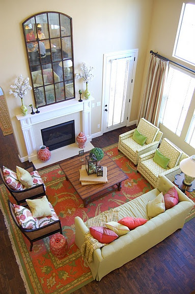 I love the tall mirror above the fireplace. LOVE the colors.