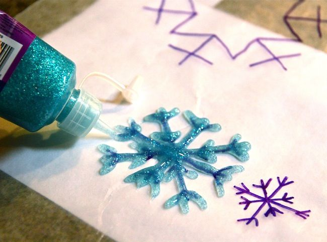DIY snowflakes with glitter glue, use wax paper over your template, make thick enough to not break, dry overnight, peel off, thread and needle through the snowflake to make the hand get.